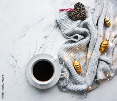 Cup of coffee, scarf and garland - 239452918