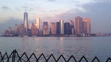 Beautiful view of New York skyline and Lower Manhattan from Staten Island Ferry boat during sunset - 239460785