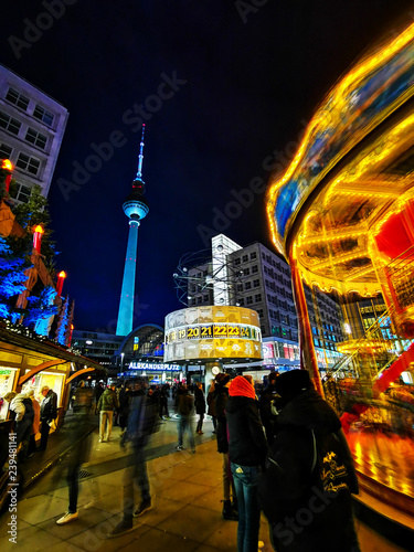 BERLIN, GERMANY-DECEMBER 16, 2018: Beautiful decorated booths and christmas lights at Alexanderplatz Christmas Market. © ilolab