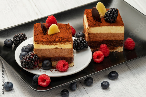 chocolate cake with fresh berries - 239483312