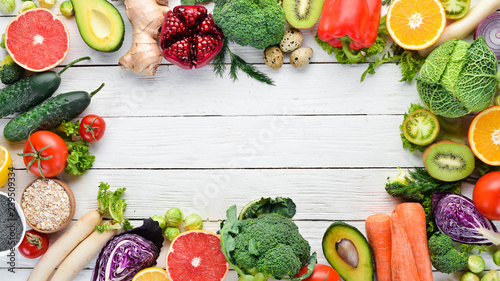 Fresh vegetables and fruits on a white wooden background. Healthy Organic Food. Top view. Free copy space. - 239509334