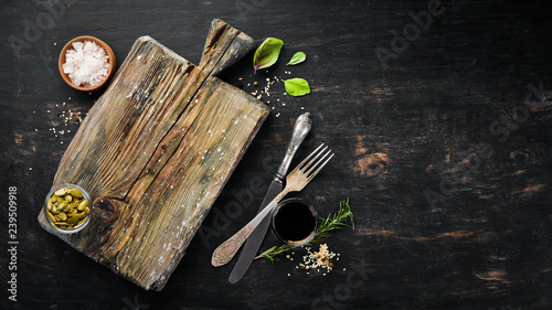 Kitchen wooden board. Food Background. On a wooden background. Top view. Free space for your text. - 239509918