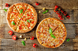 Pizza with cheese, chicken and fresh tomato slices - 239512332