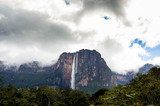 dramatic view from distance of angel falls in venezuela canaima park with dark moody cloudy sky
