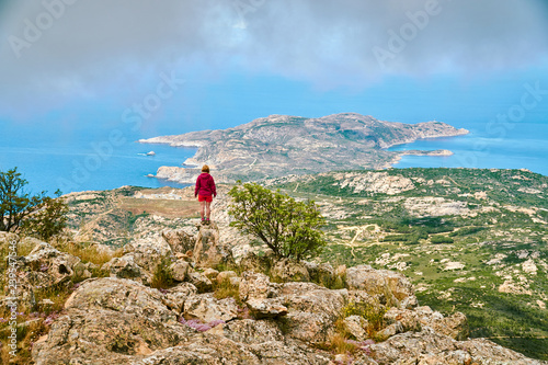 1ca976e8151b Blonde outdoor girl standing high over the sea in Corsica Corse France on cloudy  summer day