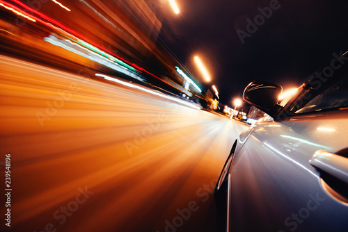 Car on the road with motion blur background. - 239548196