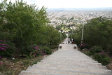 walk down the stairs to the city of Olgin Cuba view from above the city