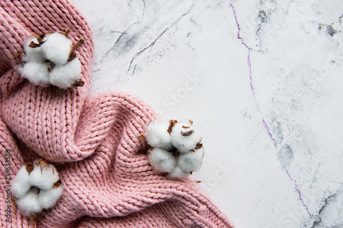 Pink knited sweater and cotton flowers