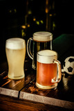 Selection of different types of beer in glasses in pub with soccer ball, football championship concept, copy space