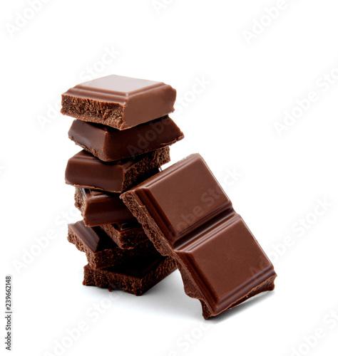 obraz lub plakat Dark milk chocolate bars stack isolated on a white
