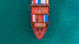 Container ship carrying container for import and export, Aerial view business logistic and freight transportation by ship in open sea.