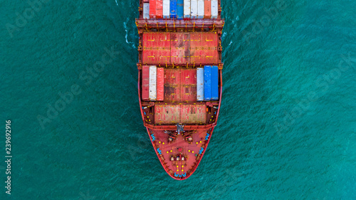 Leinwanddruck Bild Container ship carrying container for import and export, Aerial view business logistic and freight transportation by ship in open sea.