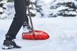 Leinwanddruck Bild - Man shoveling snow