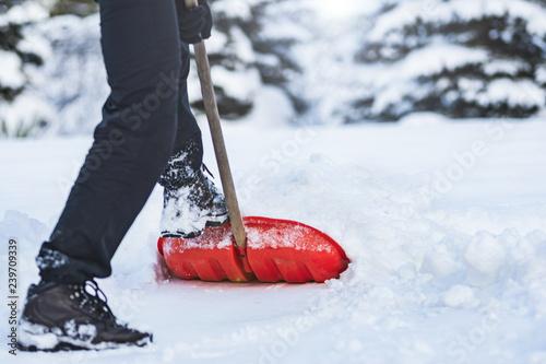 Leinwanddruck Bild Man shoveling snow
