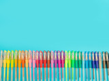 colored felt-tip pens on a pastel colored background © Lsantilli