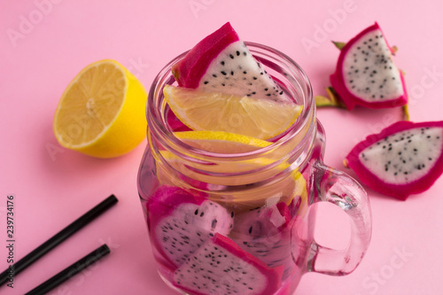 Foto Murales Detox water with dragon fruit and lemon on the pink  background.Closeup.