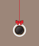 Tazzina di caffè appesa come decorazione natalizia