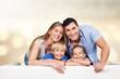 Quadro Beautiful smiling family sitting at sofa at home