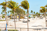 View on Bahia Honda State park, Florida key after, in aftermath of hurricane Irma, palm trees, gazebo, picnic area, closed for repair, construction work, sand trucks, building