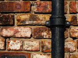 brick wall with pipe