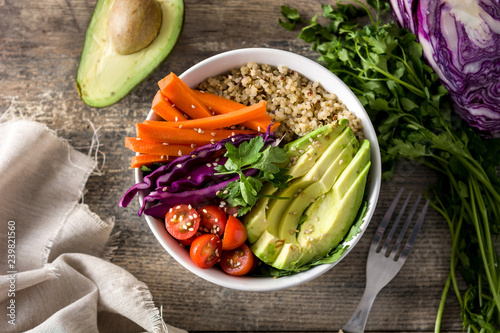 Vegan Buddha bowl with fresh raw vegetables and quinoa on wooden table. Top view - 239821560