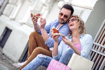 Lovely couple eat pizza outdoors © ivanko80