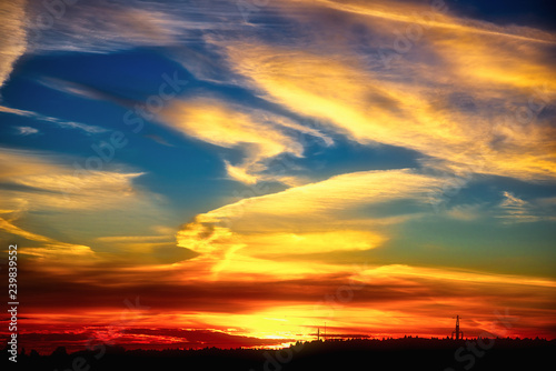 obraz lub plakat Sunset in clouds colorful