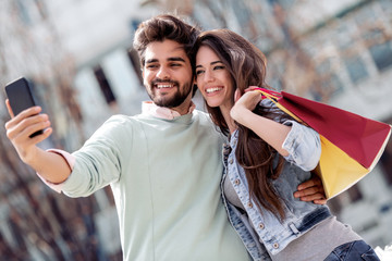 Happy couple taking selfie after shopping © ivanko80