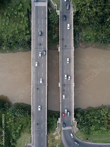 Top down aerial view of road bridges above the river. - 239845913