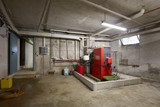 Basement with red heating boiler in old house interior - 239858509
