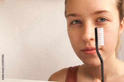 a young girl and a toothbrush - 239873183