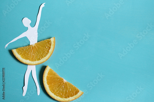 Orange fruit background with ballet dancer, citrus exotic fruit, healthy food, summer.  - 239889711