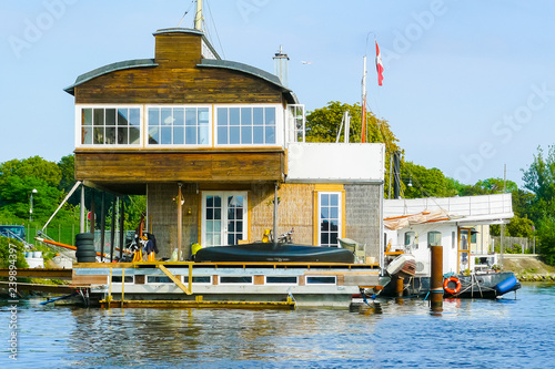typical Danish house on the water Copenhagen on a sunny day