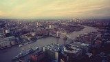 time lapse London skyline with illuminated Tower bridge and Canary Wharf in sunset time, UK - 239902521
