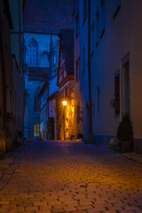 Medieval city street at night. © roostler