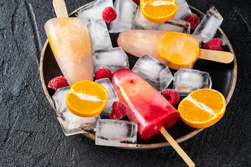 Homemade popsicles with berries and fruits,. Fruit ice cream.