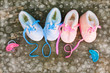 Leinwanddruck Bild -      2019 new year written laces of children's shoes and pacifier on old wooden background. Top view. Flat lay.