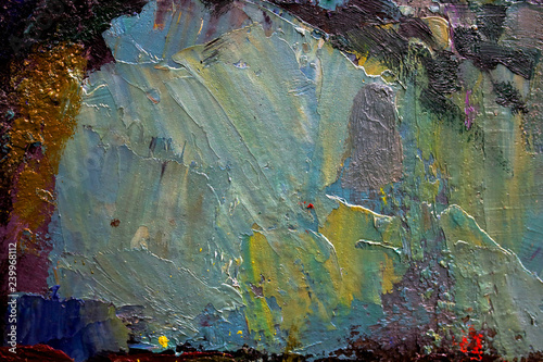 multi-colored strokes of oil paint on the artist's palette. background