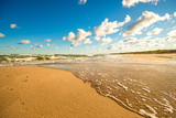beach of the Baltic Sea with blue sky and clouds