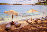 Sunshade and sunlounger on a beach, Lone Bay, Croatia