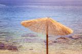 Sunshade and clear water on the beach, Lone Bay, Croatia