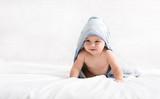 Cute little baby boy in hooded towel after bath © Prostock-studio