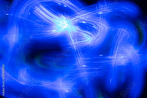 Leinwanddruck Bild blue neon abstract background image. Drawing with light, motion blur