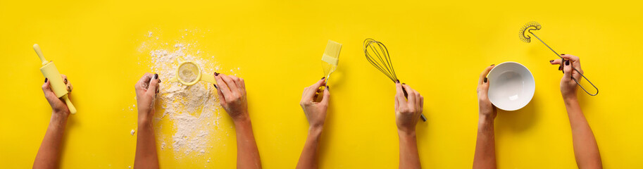 Female hands holding kitchen tools, sieve, rolling pin, bowl, sieve, brush, whisk, spatula for baking and cooking over yellow background. Food frame, bake concept with copy space © jchizhe