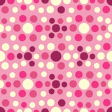 Seamless abstract pattern with geometric pattern of multicolored circles.