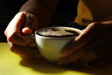Hot coffee on yellow background