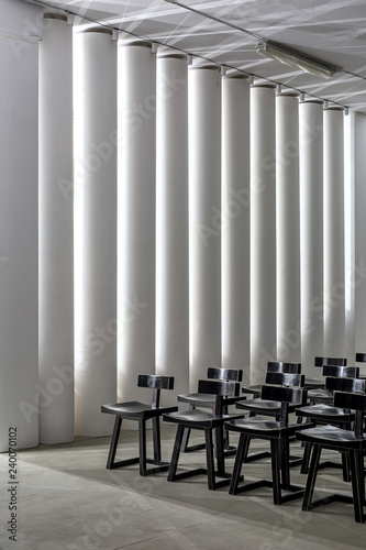 Dark wooden chairs on the background of the white columns