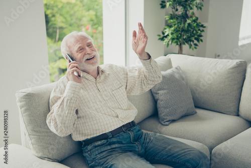 Leinwandbild Motiv Portrait of nice cheerful positive old man sitting on divan talk