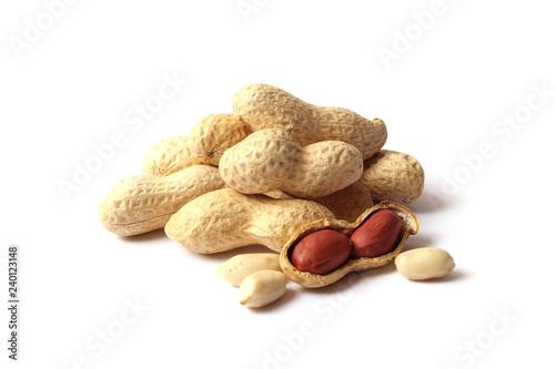 obraz lub plakat raw peanuts in shell on white background