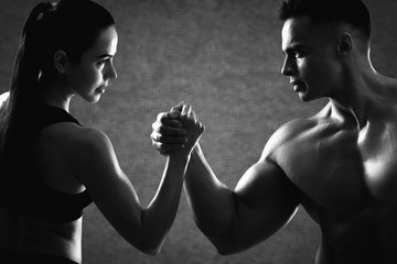 Bodybuilder couple fit lifting man weight woman black